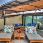 Rooftop chairs under pergola